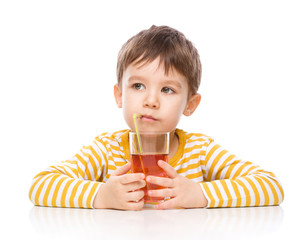 Little boy with glass of apple juice