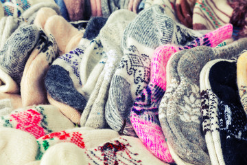 Many knitted woolen socks on the counter
