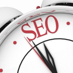 Time for seo concept clock closeup on white with red word