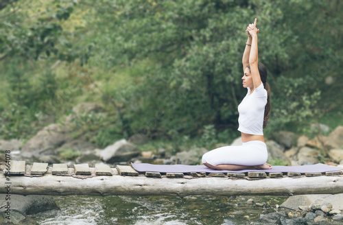canvas print picture Woman and man doing yoga in nature