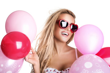 Young beautiful woman with glasses holding pink balloons, valent