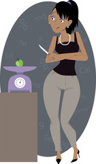 Crash diet. Woman weighing a small apple