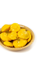 Pickled Pattypan Squash on white background. Selective focus.