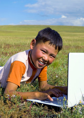 Mongolian Boy Laptop Grass Happiness Smiling Concept