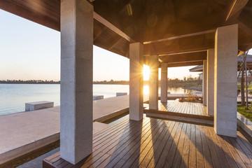 resort lakeside pavilion at sunset