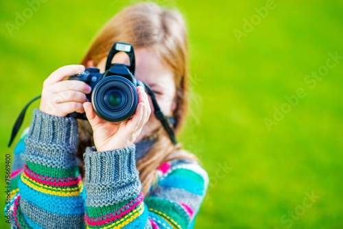 Girl Taking Pictures by DSLR - 75669400