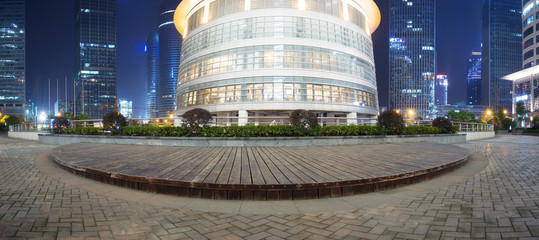 panoramic modern office building and street at night