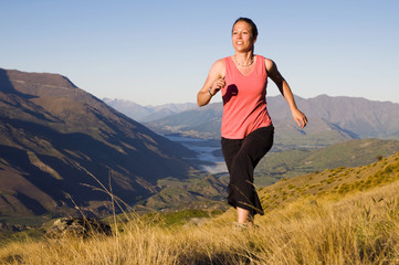 Young Woman Jogging Wilderness Mountain Concept