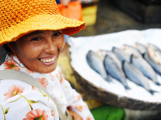 Indigenous Cambodian Woman Selling Fish Concept