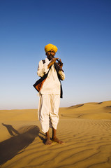 Indigenous Indian Playing Wind Pipe Desert Concept