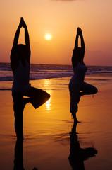 Serene People Beach Doing Yoga Sunset Concept