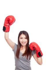 Young Asian woman with red boxing glove