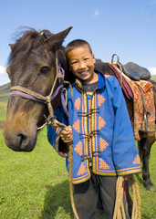 Little Boy Tilting His Head To His Horse And Smiling At Outdoors