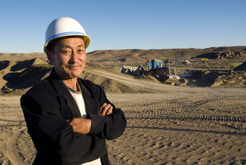 Construction Man With Arms Crossed Standing And Smiling In A Con