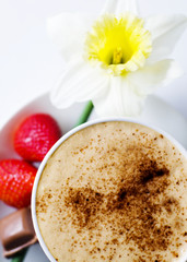 Coffee Mocha With Strawberries, Chocolate And Flower As Garnish