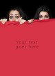 Girls hiding behind red cloth card