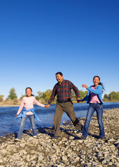 Mongolian Family Anjoy Walking by The River Concept