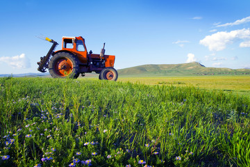 Side View Of A Tractor In A Scenic View