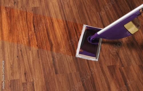 Modern mop for cleaning wooden floor from dust - 75671408