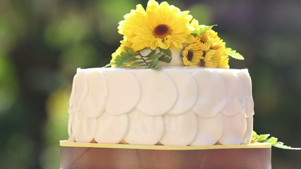 white creamy cake decorated with yellow chrysanthemum flowers ro