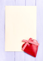 Empty sheet of paper with a vintage heart decoration