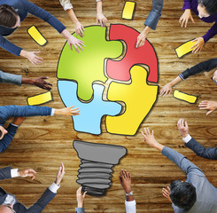 Business People Light Bulb Innovation Jigsaw Togetherness Concep