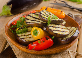 Grilled vegetable  slices on  a wooden plate