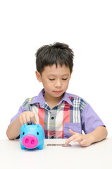 Asain boy counting coins from piggybank isolated on white