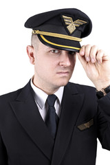 Serious young pilot in uniform on a white background