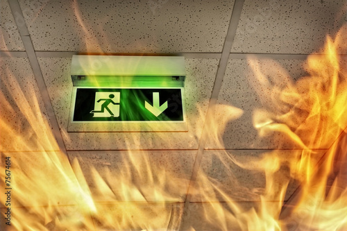 Fire in the building - emergency exit - 75674614