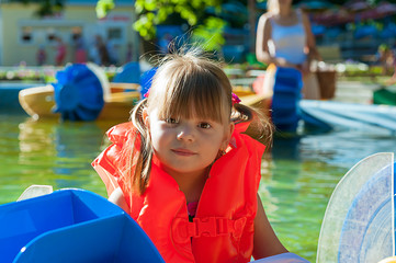 little girl in a life jacket