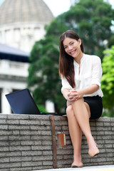 Business woman on laptop in Hong Kong