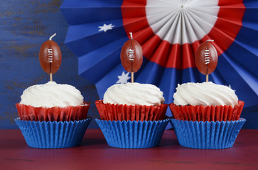 Red, white and blue theme cupcakes with football candles