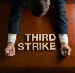 Phrase Third Strike and devastated man composition