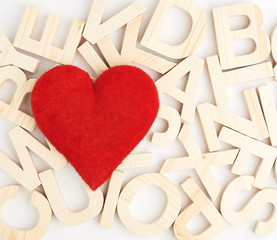 Heart over the wooden letters