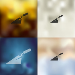 trowel icon on blurred background