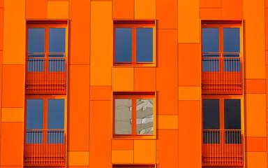 Orange, modern apparment building.