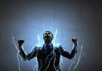 Businessman with lightning