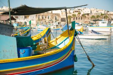 Traditional luzzu boat at Marsaxlokk village, Malta