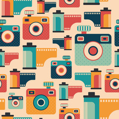 Seamless pattern with colorful retro cameras and films.