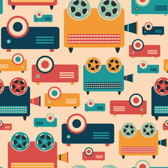 Seamless pattern with colorful retro video projectors.