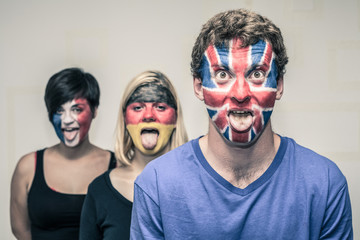 Funny people with European flags on faces