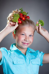 Cheerful girl posing with horns made of broccoli