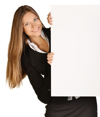 Business woman looks out from behind a blank white sheet of