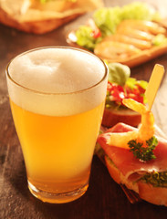 Buffet of assorted tapas with a glass of beer