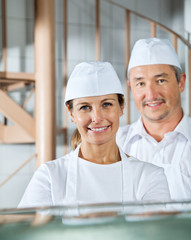 Confident Butchers Smiling In Butchery