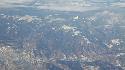 Flying over snowy mountain tops
