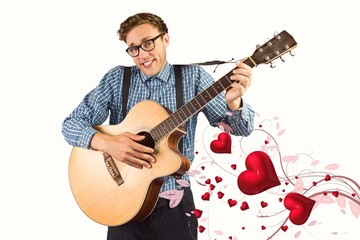 Composite image of geeky hipster playing the guitar