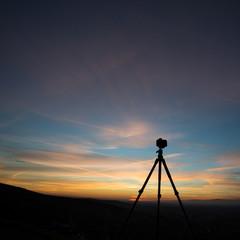 silhouette of camera on tripod