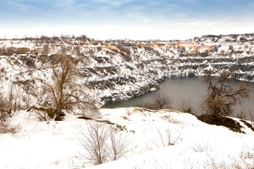 flooded granite quarry in winter
